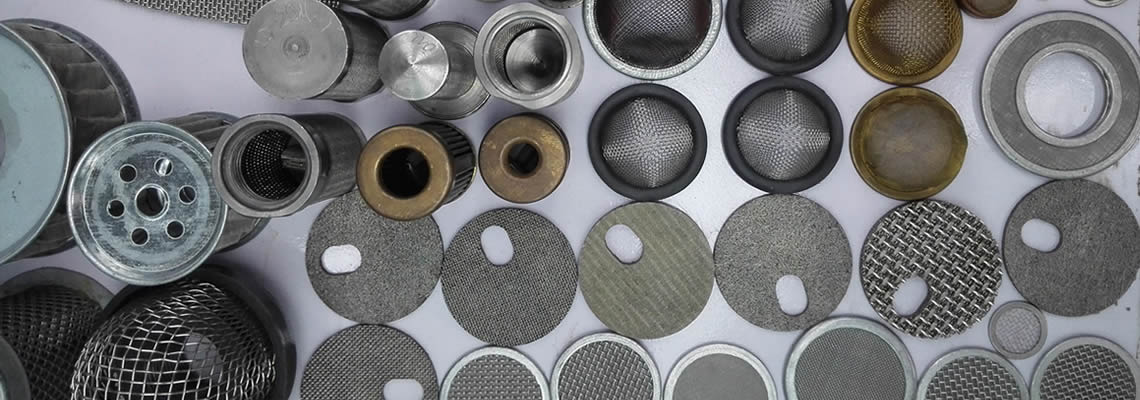 Various types of filter discs, filter baskets and filter tubes on a white background.