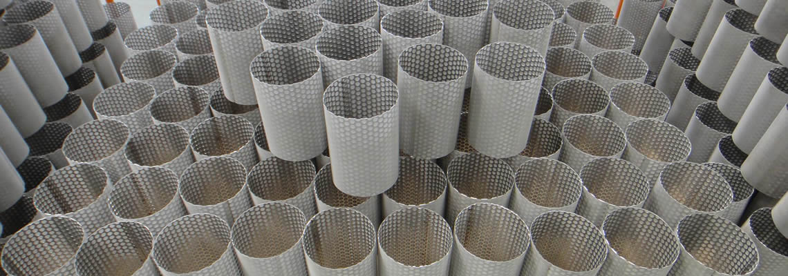 Many cylindrical filter tubes made by perforated metal steel. They are all covered with a layer of fine woven wire mesh.